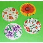 štirje različni podstavki s cvetličnimi vzorci