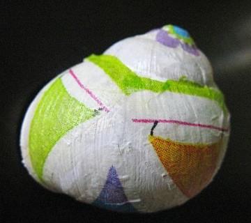 polžja hišica oblečena v servietke