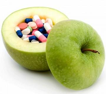 tabletke v notranjosti izdolbenega jabolka