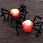 svečniki iz jabolk v obliki pajka